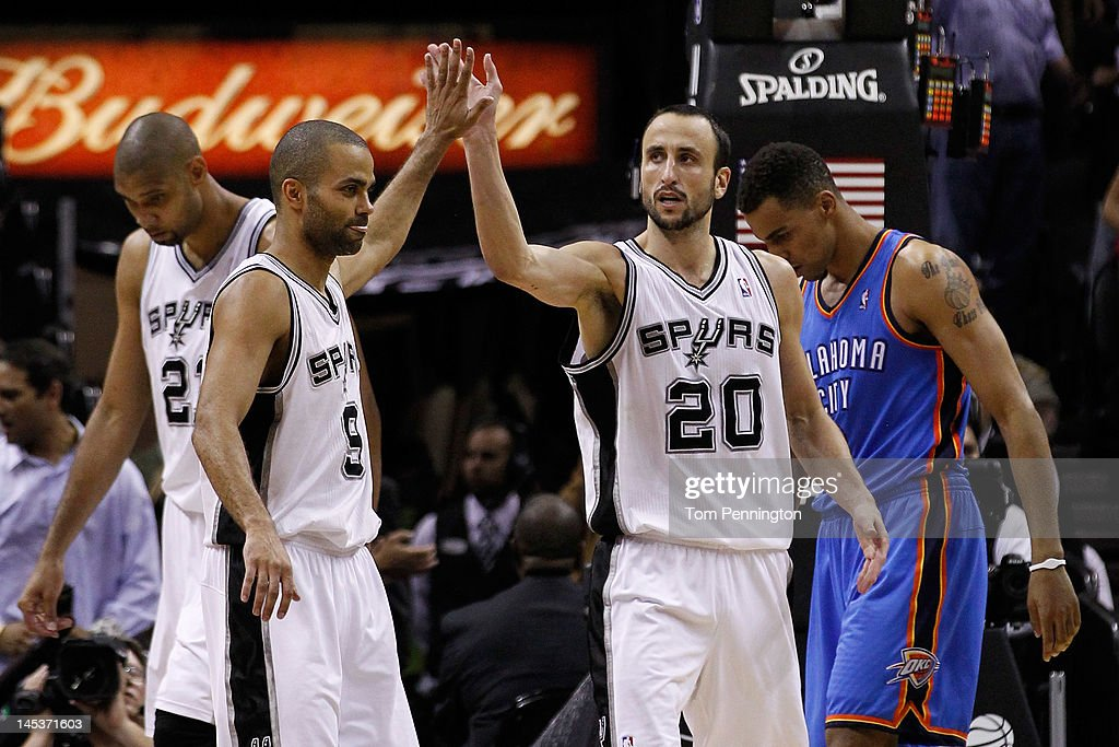 Tony Parker #9 and Manu Ginobili #20 of the San Antonio Spurs celebrate a play in front of Thabo Sefolosha #2 of the Oklahoma City Thunder in the fourth quarter in Game One of the Western Conference Finals of the 2012 NBA Playoffs at AT&T Center on May 27, 2012 in San Antonio, Texas.