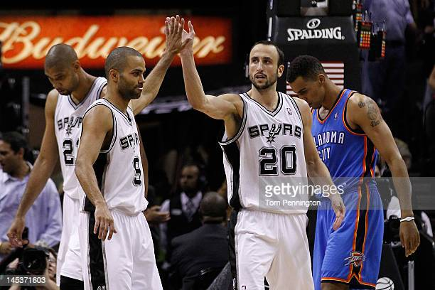 Tony Parker and Manu Ginobili of the San Antonio Spurs celebrate a play in front of Thabo Sefolosha of the Oklahoma City Thunder in the fourth...