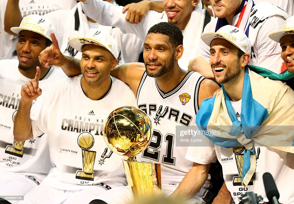 Tony Parker and Tim Duncan and Manu Ginobili of the San Antonio Spurs celebrate after defeating the Miami Heat in Game Five of the 2014 NBA Finals at...