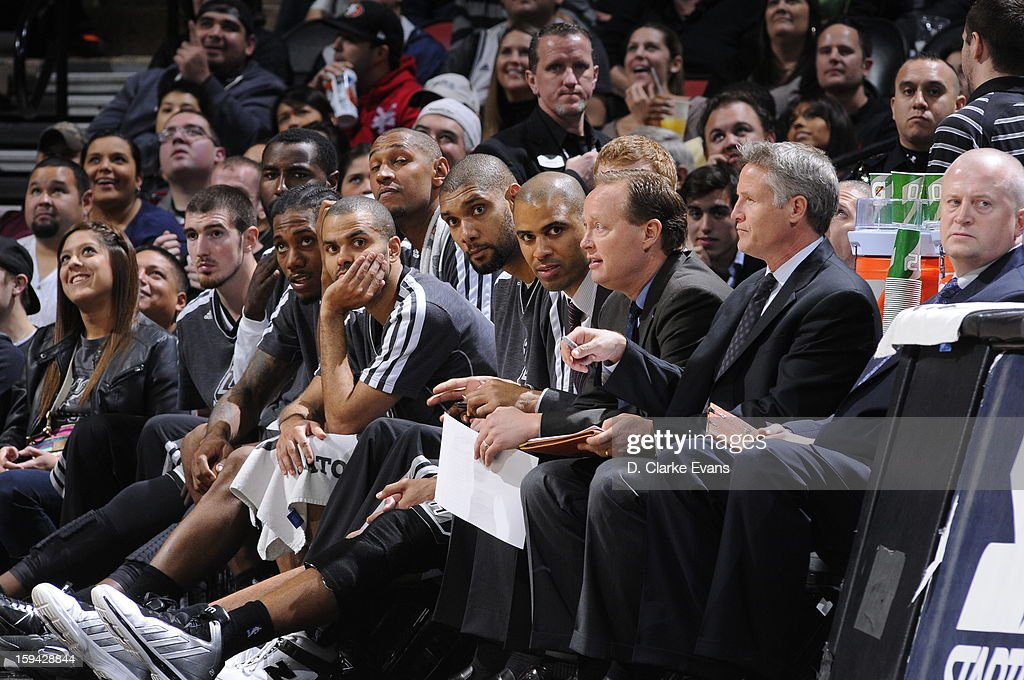 Tony Parker #9 and Tim Duncan #21 of the San Antonio Spurs on the bench during the game against the Minnesota Timberwolves on January 13, 2013 at the AT&T Center in San Antonio, Texas.
