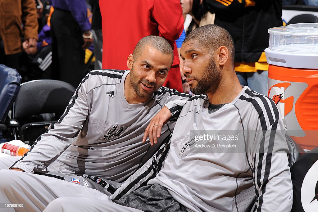 Tony Parker #9 and <a gi-track='captionPersonalityLinkClicked' href=/galleries/search?phrase=Tim+Duncan&family=editorial&specificpeople=201467 ng-click='$event.stopPropagation()'>Tim Duncan</a> #21 of the San Antonio Spurs sit on the bench before the game against the Los Angeles Lakers at Staples Center on April 14, 2013 in Los Angeles, California.