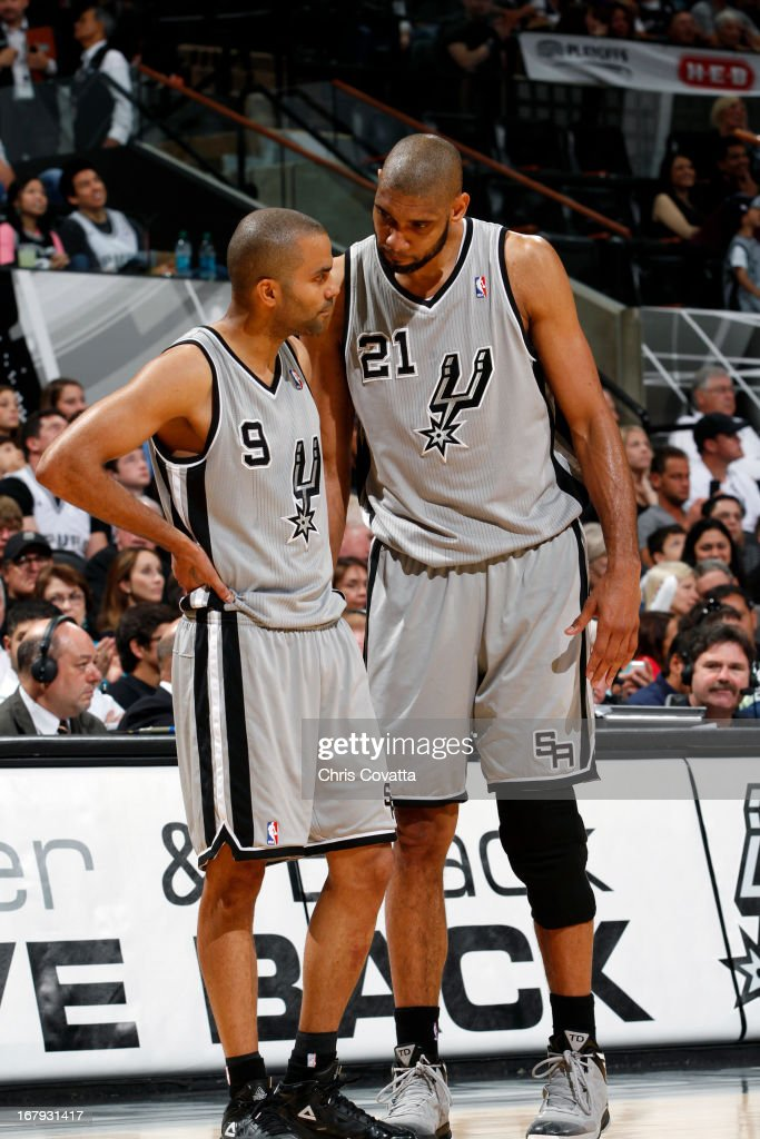 Tony Parker #9 and Tim Duncan #21 of the San Antonio Spurs talk during the game against the Los Angeles Lakers in Game One of the 2013 NBA Playoffs at the AT&T Center on April 21, 2013 in San Antonio, Texas.
