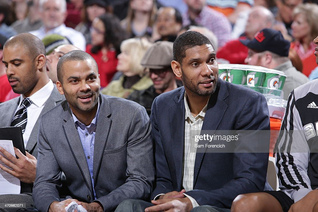Tony Parker #9 and <a gi-track='captionPersonalityLinkClicked' href=/galleries/search?phrase=Tim+Duncan&family=editorial&specificpeople=201467 ng-click='$event.stopPropagation()'>Tim Duncan</a> #21 of the San Antonio Spurs talk on the bench against the Portland Trail Blazers on February 19, 2014 at the Moda Center Arena in Portland, Oregon.