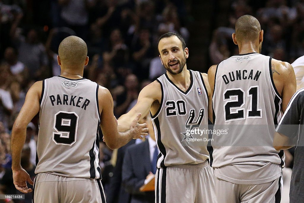 <a gi-track='captionPersonalityLinkClicked' href=/galleries/search?phrase=Tony+Parker&family=editorial&specificpeople=160952 ng-click='$event.stopPropagation()'>Tony Parker</a> #9, Manu Ginobili #20 and <a gi-track='captionPersonalityLinkClicked' href=/galleries/search?phrase=Tim+Duncan&family=editorial&specificpeople=201467 ng-click='$event.stopPropagation()'>Tim Duncan</a> #21 of the San Antonio Spurs celebrate a play as they walk to the bench during a timout in overtime against the Memphis Grizzlies during Game Two of the Western Conference Finals of the 2013 NBA Playoffs at AT&T Center on May 21, 2013 in San Antonio, Texas.