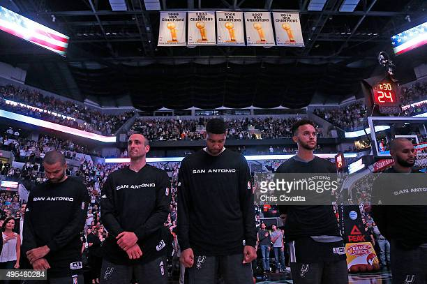 Tony Parker Manu Ginobili Tim Duncan Kyle Anderson and Patty Mills of the San Antonio Spurs stand during the national anthem before playing the...