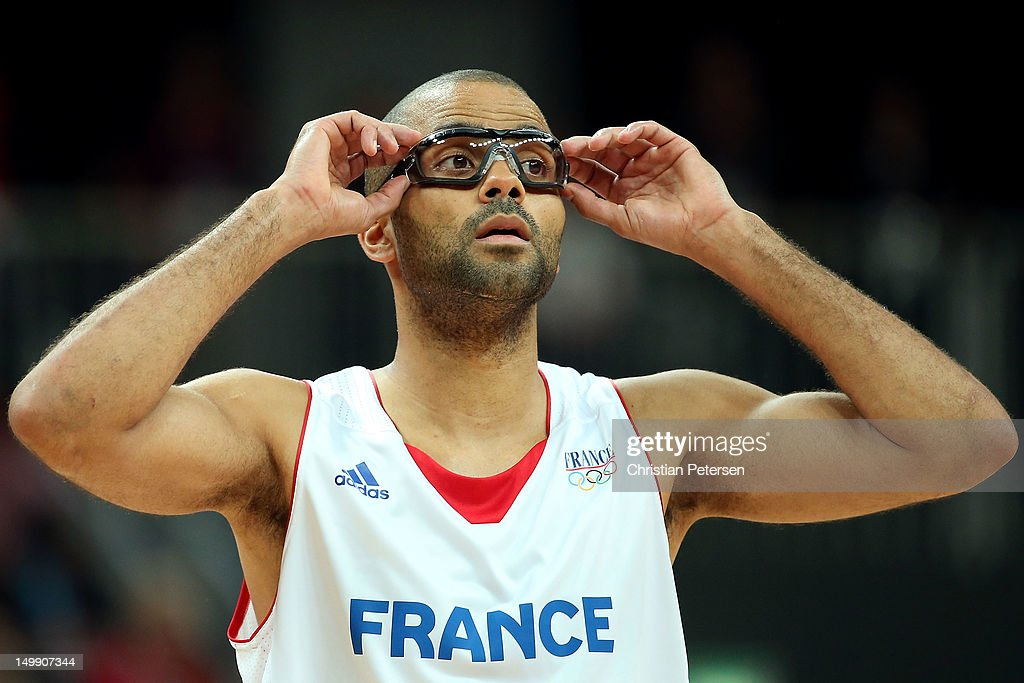Tony Parker of France asjusts his protective glasses as he looks on against Nigeria during the Men's Basketball Preliminary Round match on Day 10 of...