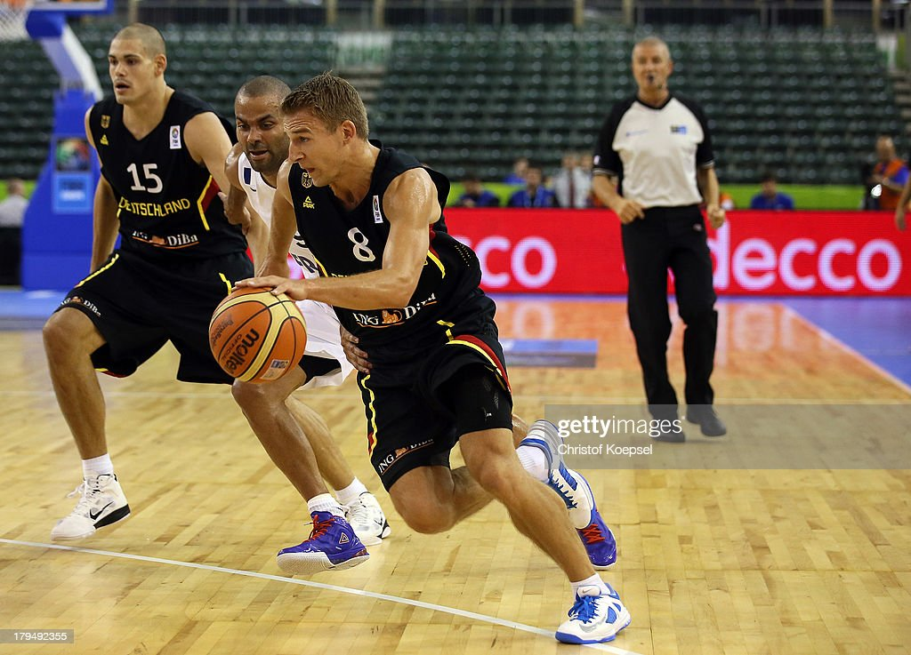 Tony Parker of France defends against Heiko Schaffartzik of Gemany during the FIBA European Championships 2013 first round group A match between France and Germany at Tivoli Arena on September 4, 2013 in Ljubljana, Slovenia.