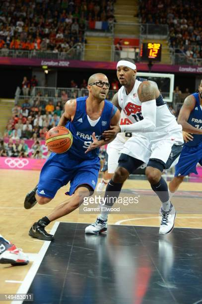Tony Parker of France dribbles against Carmelo Anthony of the United States at the Olympic Park Basketball Arena during the London Olympic Games on...