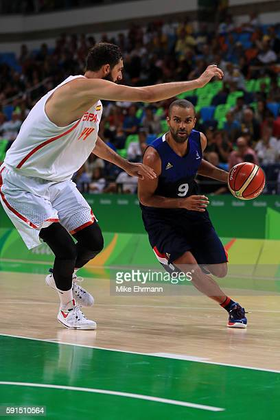 Tony Parker of France drives against Nikola Mirotic of Spain during the Men's Quarterfinal match on Day 12 of the Rio 2016 Olympic Games at Carioca...