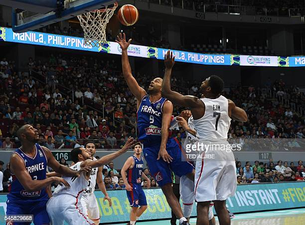 Tony Parker of France laysup against Melvin Ejim of Canada during their game at the 2016 FIBA Olympic men's qualifying basketball tournament in...