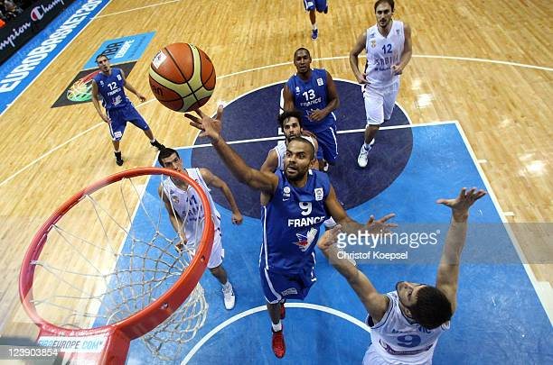 Tony Parker of France scorres against Stefan Markovic of Serbia during the EuroBasket 2011 first round group B match between Serbia and France at...