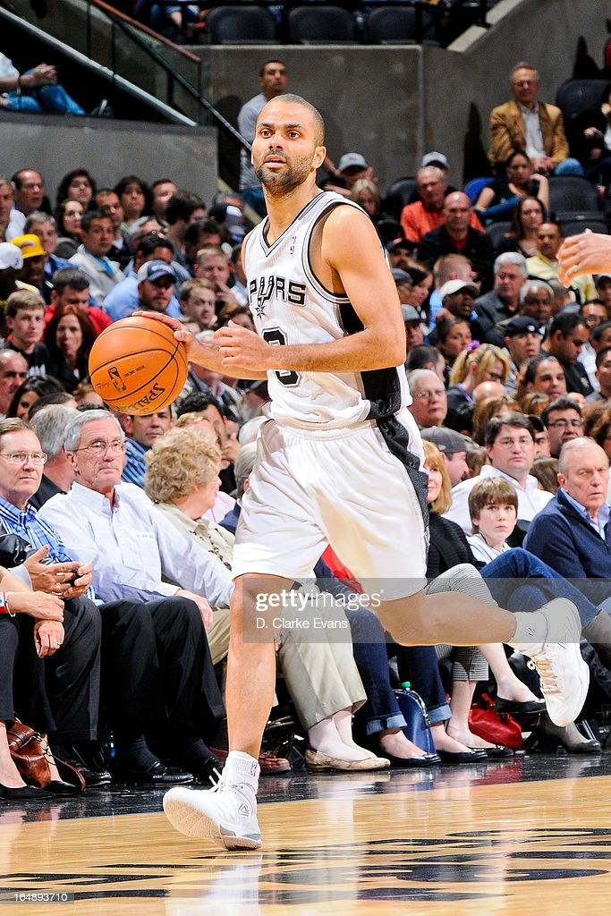 Tony Parker #9 of the San Antonio Spurs advances the ball against the Denver Nuggets on March 27, 2013 at the AT&T Center in San Antonio, Texas.