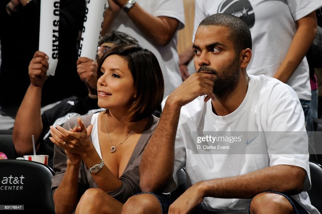 Tony Parker of the San Antonio Spurs and his wife Eva Longoria watch the game between the San Antonio Silver Stars and the Los Angeles Sparks in Game...