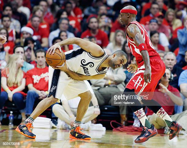 Tony Parker of the San Antonio Spurs and Jason Terry of the Houston Rockets battle for position during their game at the Toyota Center on December 25...