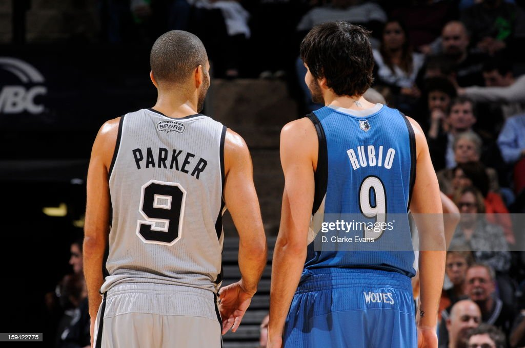 Tony Parker #9 of the San Antonio Spurs and Ricky Rubio #9 of the Minnesota Timberwolves during the game on January 13, 2013 at the AT&T Center in San Antonio, Texas.