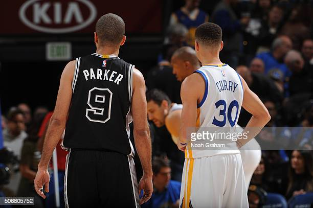 Tony Parker of the San Antonio Spurs and Stephen Curry of the Golden State Warriors on January 25 2016 at Oracle Arena in Oakland California NOTE TO...