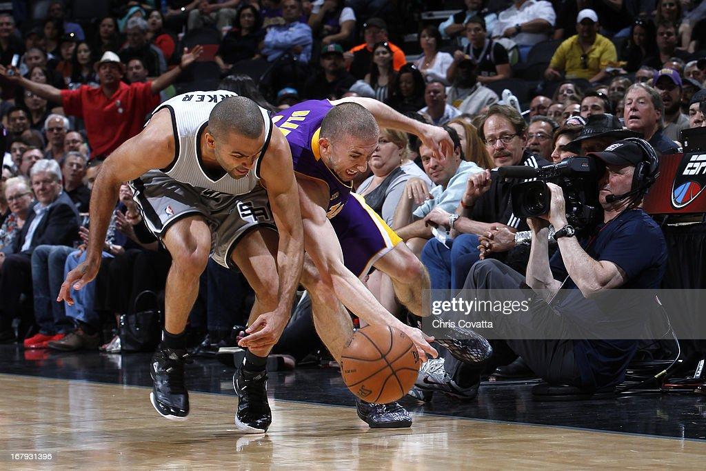 Tony Parker #9 of the San Antonio Spurs and Steve Blake #5 of the Los Angeles Lakers battle for a loose ball in Game One of the 2013 NBA Playoffs at the AT&T Center on April 21, 2013 in San Antonio, Texas.