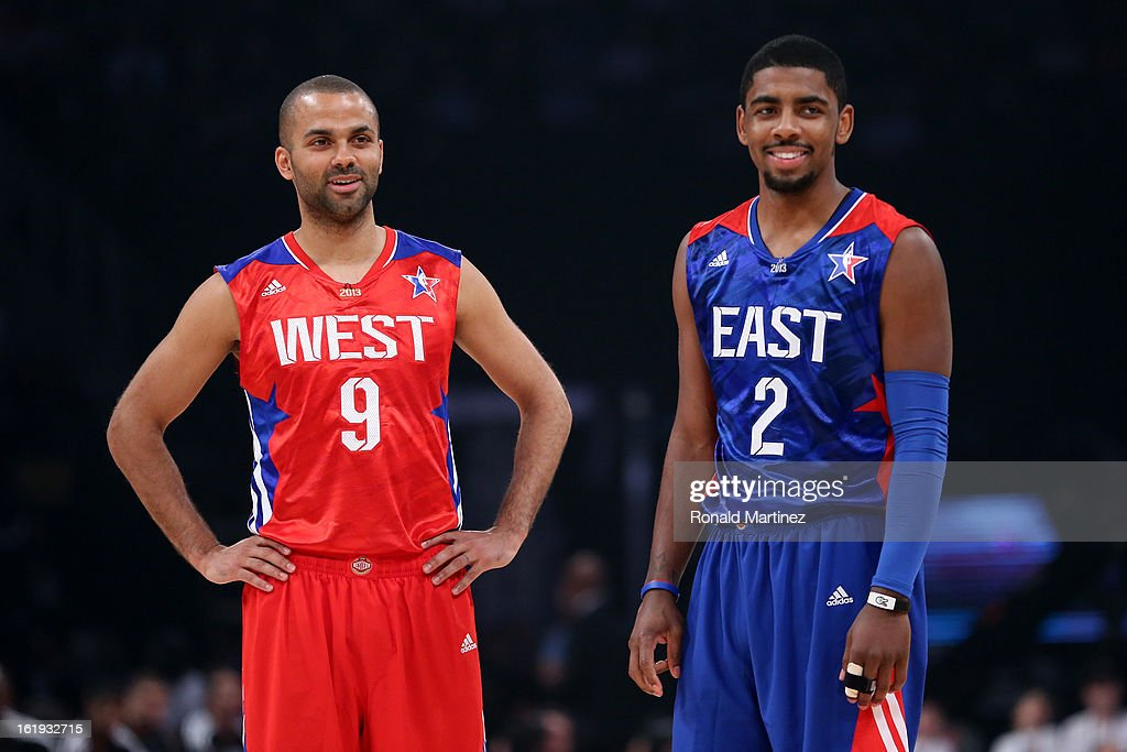 Tony Parker #9 of the San Antonio Spurs and the Western Conference stands with Kyrie Irving #2 of the Cleveland Cavaliers and the Eastern Conference in the second quarter during the 2013 NBA All-Star game at the Toyota Center on February 17, 2013 in Houston, Texas.