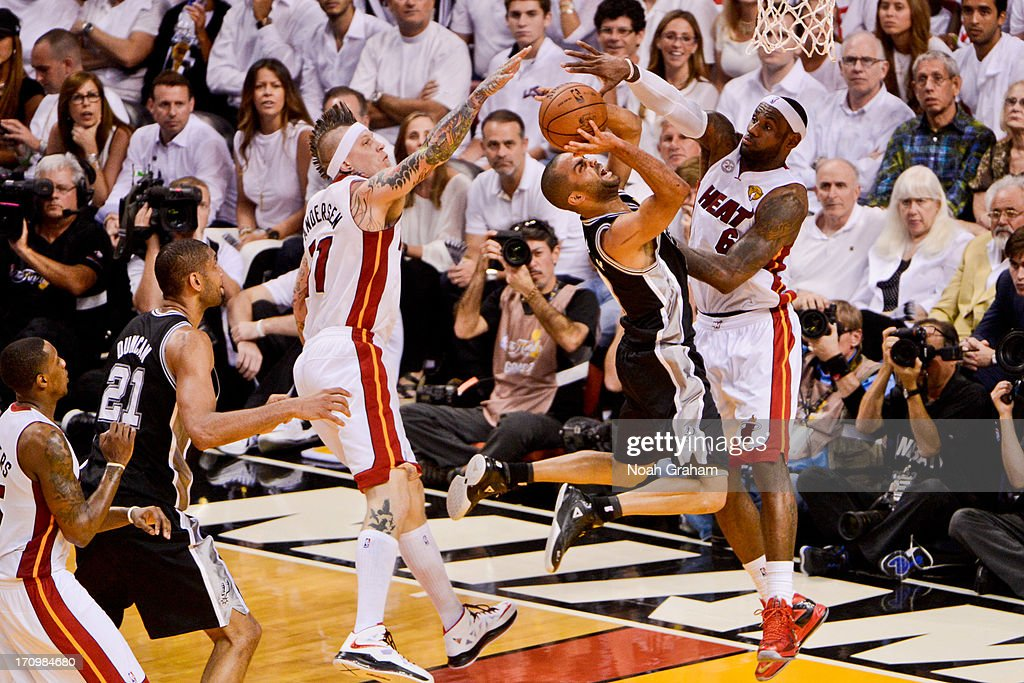 Tony Parker #9 of the San Antonio Spurs attempts a layup against LeBron James #6 and Chris Andersen #11 of the Miami Heat during Game Seven of the 2013 NBA Finals on June 20, 2013 at American Airlines Arena in Miami, Florida.