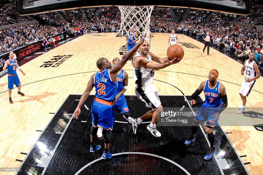 Tony Parker #9 of the San Antonio Spurs attempts a reverse layup against <a gi-track='captionPersonalityLinkClicked' href=/galleries/search?phrase=Raymond+Felton&family=editorial&specificpeople=209141 ng-click='$event.stopPropagation()'>Raymond Felton</a> #2 of the New York Knicks on November 15, 2012 at the AT&T Center in San Antonio, Texas.