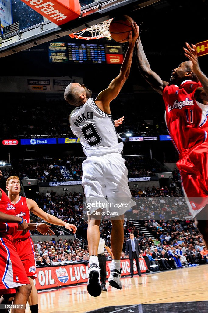 Tony Parker #9 of the San Antonio Spurs attempts a reverse layup against Jamal Crawford #11 of the Los Angeles Clippers on November 19, 2012 at the AT&T Center in San Antonio, Texas.