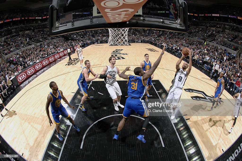 <a gi-track='captionPersonalityLinkClicked' href=/galleries/search?phrase=Tony+Parker&family=editorial&specificpeople=160952 ng-click='$event.stopPropagation()'>Tony Parker</a> #9 of the San Antonio Spurs attempts to shoot the ball in a game against the Golden State Warriors on January 18, 2013 at the AT&T Center in San Antonio, Texas.