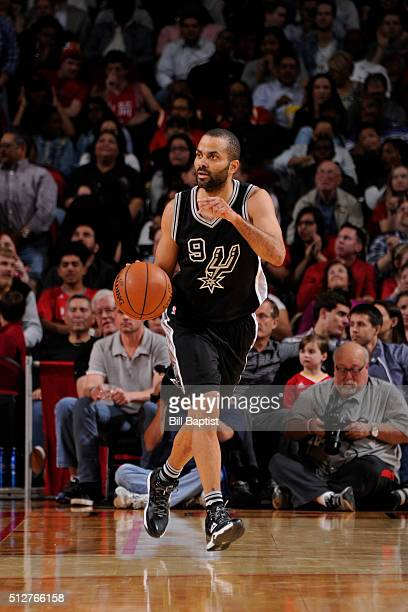 Tony Parker of the San Antonio Spurs brings the ball up court against the Houston Rockets on February 27 2016 at the Toyota Center in Houston Texas...