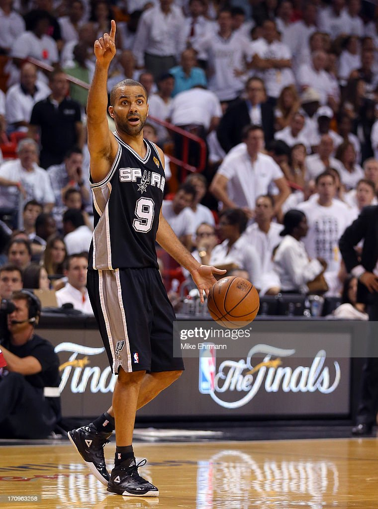 Tony Parker of the San Antonio Spurs calls a play in the third quarter while taking on the Miami Heat during Game Seven of the 2013 NBA Finals at...