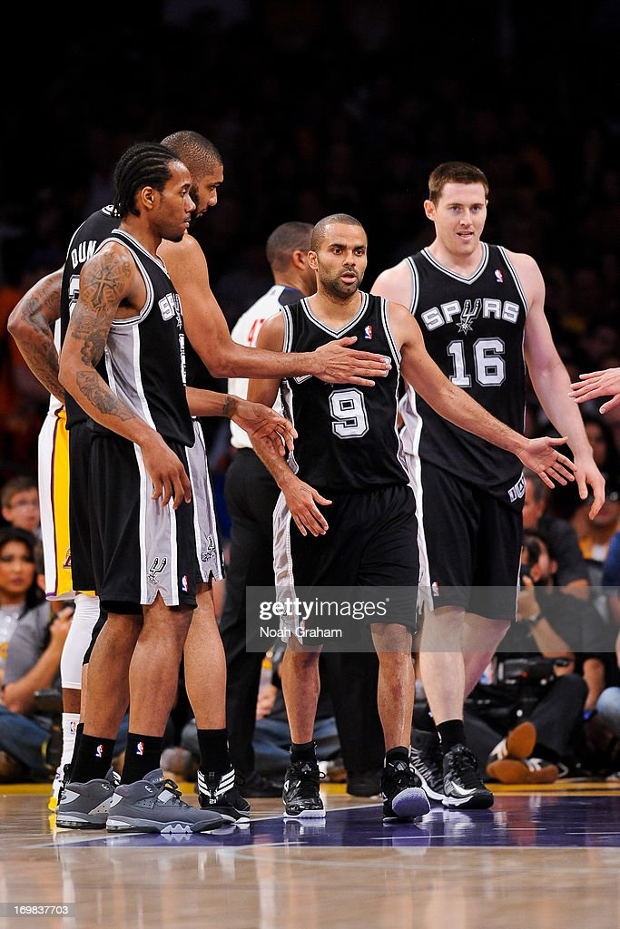 Tony Parker #9 of the San Antonio Spurs celebrates with teammates while playing the Los Angeles Lakers in Game Four of the Western Conference Quarterfinals during the 2013 NBA Playoffs at Staples Center on April 28, 2013 in Los Angeles, California.