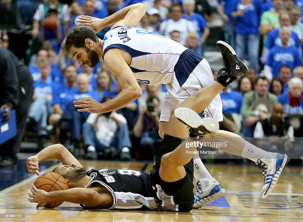 Tony Parker of the San Antonio Spurs commits a backcourt violation in front of Jose Calderon of the Dallas Mavericks in Game Six of the Western...