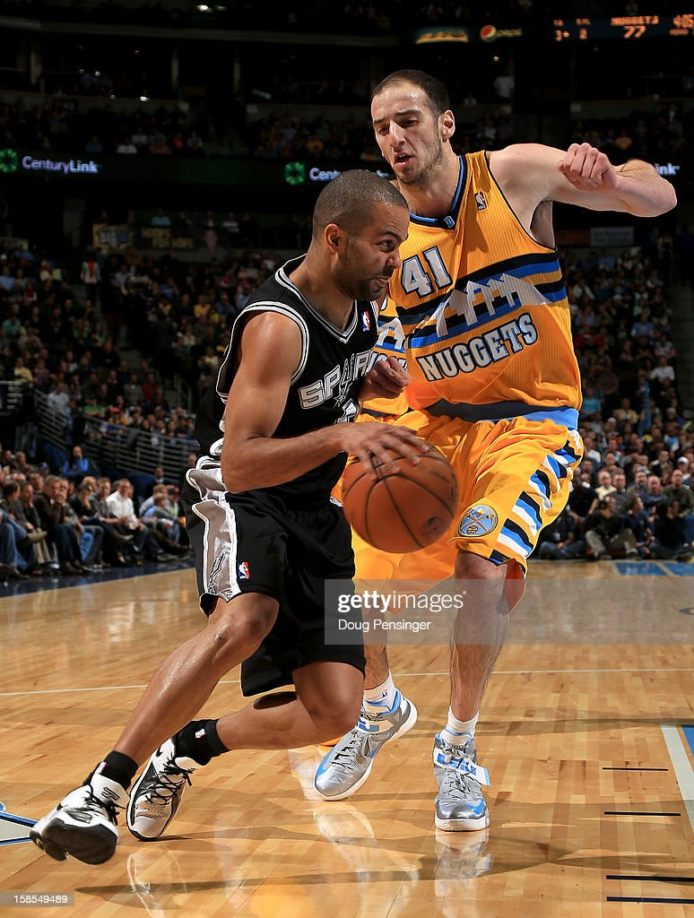 Tony Parker #9 of the San Antonio Spurs controls the ball against <a gi-track='captionPersonalityLinkClicked' href=/galleries/search?phrase=Kosta+Koufos&family=editorial&specificpeople=4216032 ng-click='$event.stopPropagation()'>Kosta Koufos</a> #41 of the Denver Nuggets at the Pepsi Center on December 18, 2012 in Denver, Colorado. The Nuggets defeated the Spurs 112-106.