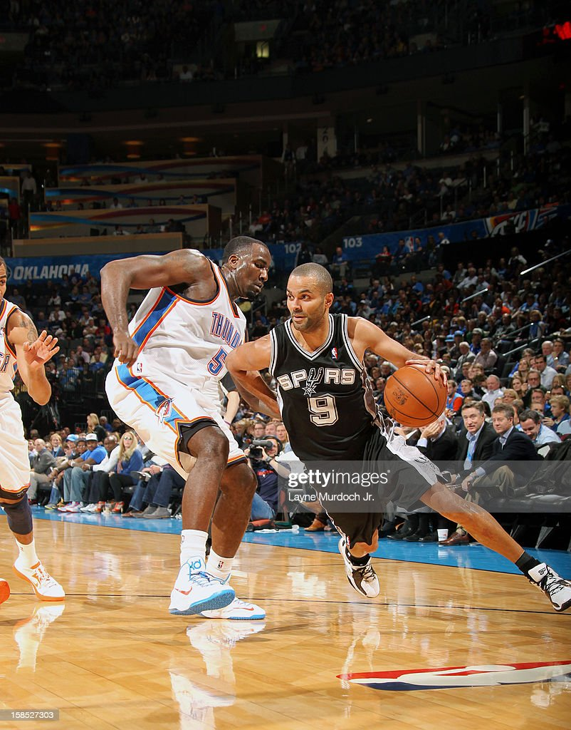 Tony Parker #9 of the San Antonio Spurs dribbles around <a gi-track='captionPersonalityLinkClicked' href=/galleries/search?phrase=Kendrick+Perkins&family=editorial&specificpeople=211461 ng-click='$event.stopPropagation()'>Kendrick Perkins</a> #5 of the Oklahoma City Thunder during an NBA game on December 17, 2012 at the Chesapeake Energy Arena in Oklahoma City, Oklahoma.