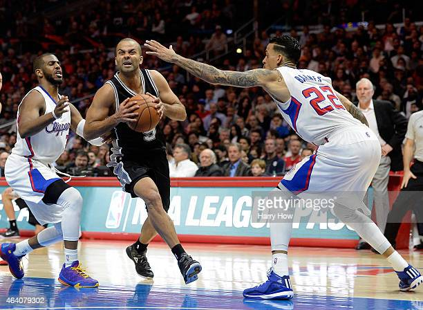 Tony Parker of the San Antonio Spurs dribbles between Matt Barnes and Chris Paul of the Los Angeles Clippers at Staples Center on February 19 2015 in...