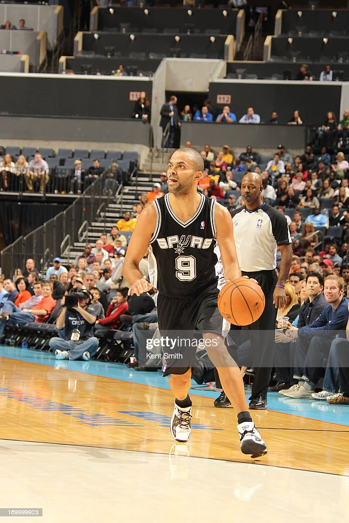 Tony Parker #9 of the San Antonio Spurs dribbles the ball against the Charlotte Bobcats at the Time Warner Cable Arena on December 8, 2012 in Charlotte, North Carolina.