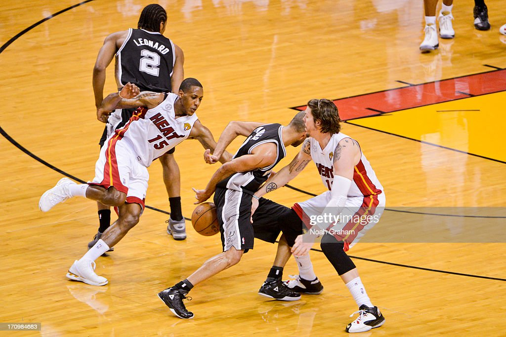 Tony Parker #9 of the San Antonio Spurs dribbles the ball behind his back against Mike Miller #13 and Mario Chalmers #15 of the Miami Heat during Game Seven of the 2013 NBA Finals on June 20, 2013 at American Airlines Arena in Miami, Florida.
