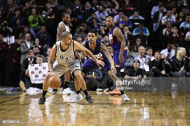 Tony Parker of the San Antonio Spurs dribbles the ball while guarded by Tyler Ulis of the Phoenix Suns as part of NBA Global Games at Arena Ciudad de...