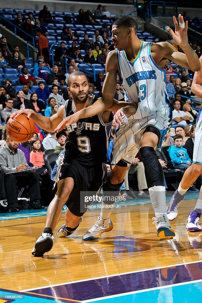 Tony Parker #9 of the San Antonio Spurs drives against Anthony Davis #23 of the New Orleans Hornets on January 7, 2013 at the New Orleans Arena in New Orleans, Louisiana.