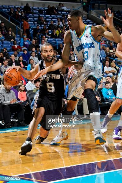 Tony Parker of the San Antonio Spurs drives against Anthony Davis of the New Orleans Hornets on January 7 2013 at the New Orleans Arena in New...