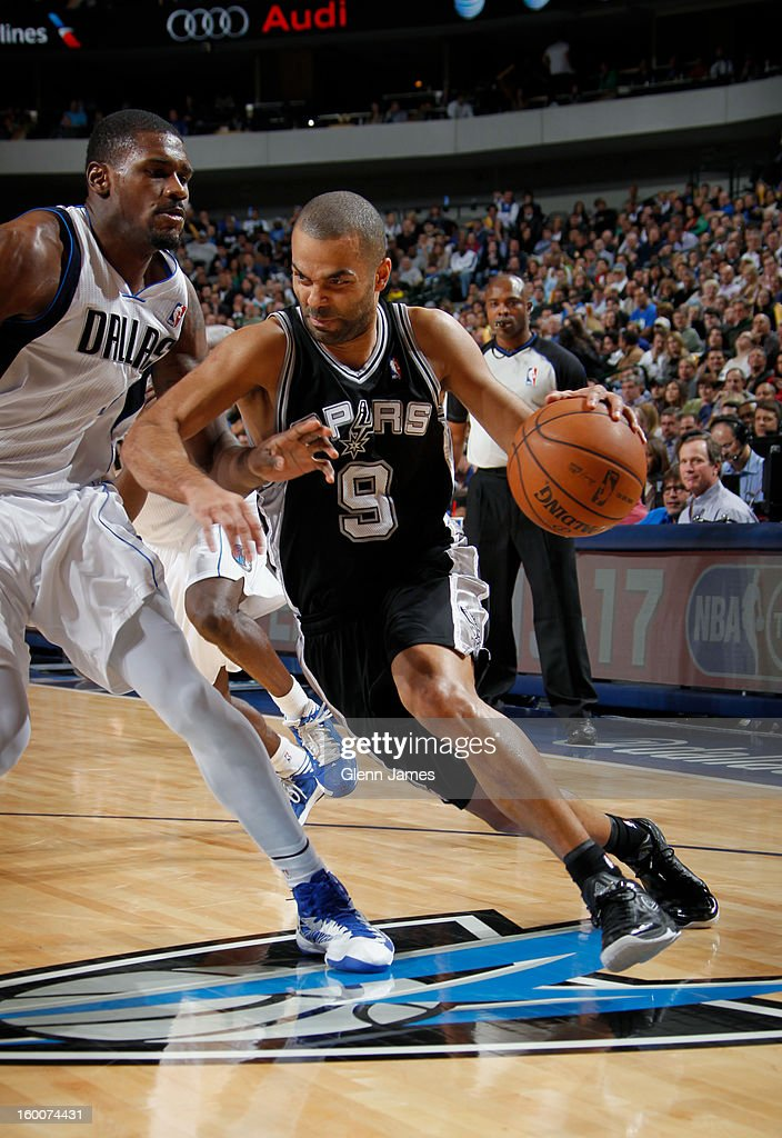 Tony Parker #9 of the San Antonio Spurs drives against Bernard James #5 of the Dallas Mavericks on January 25, 2013 at the American Airlines Center in Dallas, Texas.