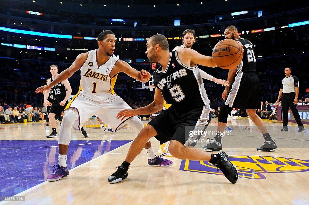 Tony Parker #9 of the San Antonio Spurs drives against Darius Morris #1 of the Los Angeles Lakers in Game Four of the Western Conference Quarterfinals during the 2013 NBA Playoffs at Staples Center on April 28, 2013 in Los Angeles, California.
