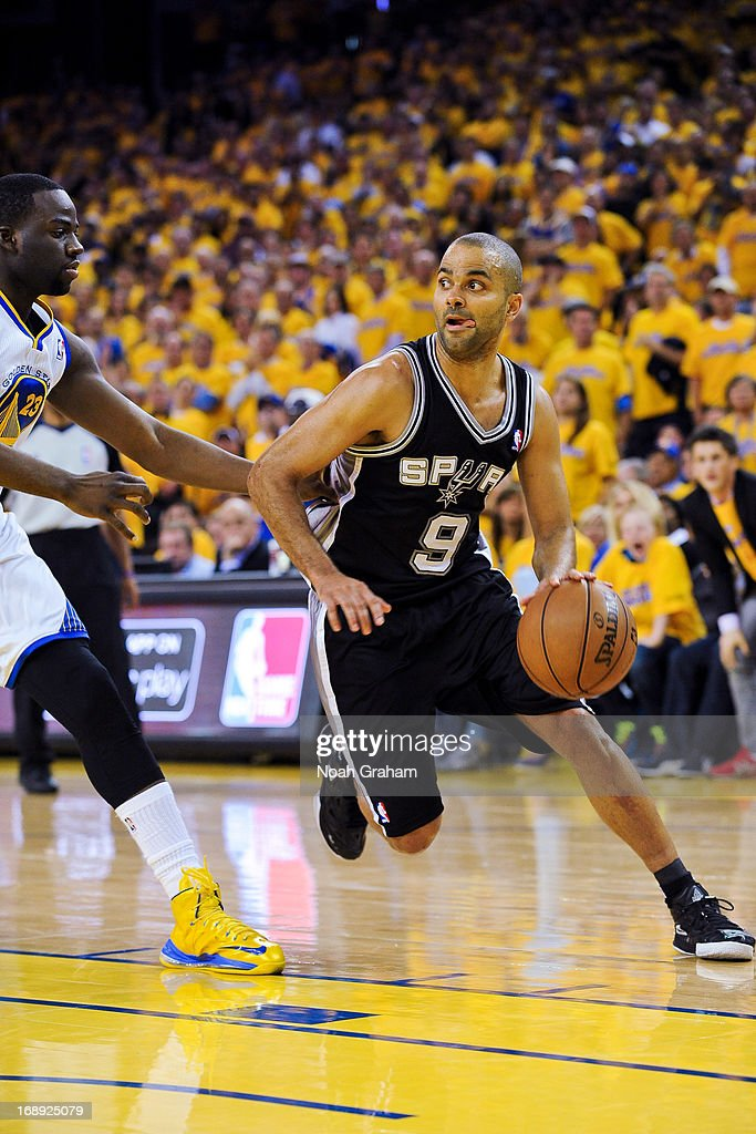 Tony Parker #9 of the San Antonio Spurs drives against Draymond Green #23 of the Golden State Warriors in Game Six of the Western Conference Semifinals during the 2013 NBA Playoffs on May 16, 2013 at Oracle Arena in Oakland, California.