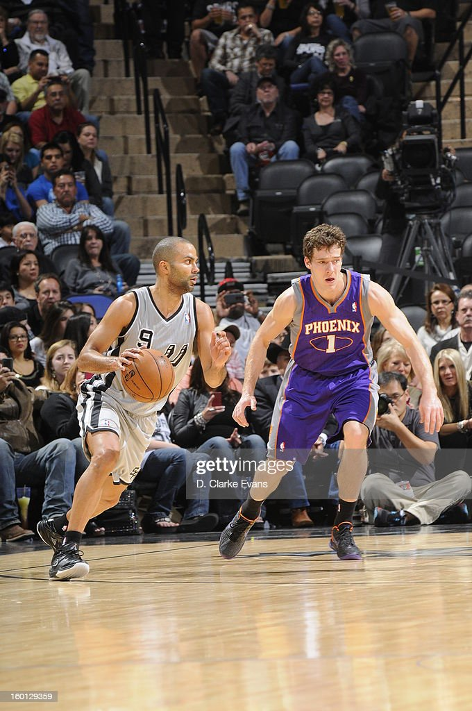Tony Parker #9 of the San Antonio Spurs drives against Goran Dragic #1 of the Phoenix Suns on January 26, 2013 at the AT&T Center in San Antonio, Texas.