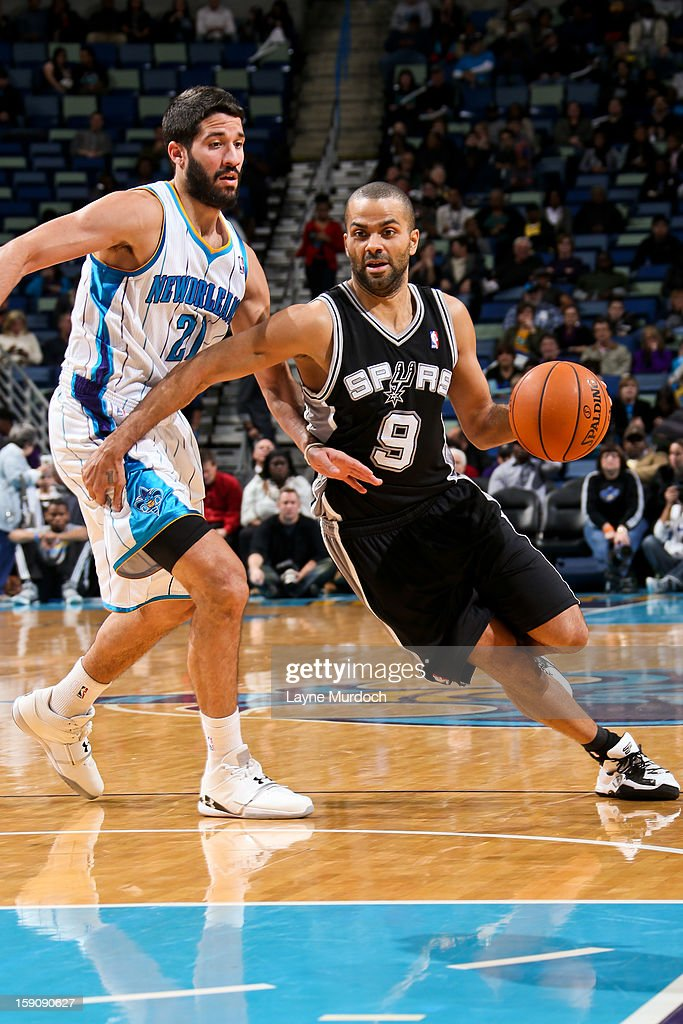 Tony Parker #9 of the San Antonio Spurs drives against Greivis Vasquez #21 of the New Orleans Hornets on January 7, 2013 at the New Orleans Arena in New Orleans, Louisiana.
