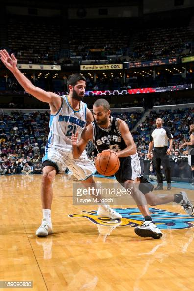 Tony Parker of the San Antonio Spurs drives against Greivis Vasquez of the New Orleans Hornets on January 7 2013 at the New Orleans Arena in New...