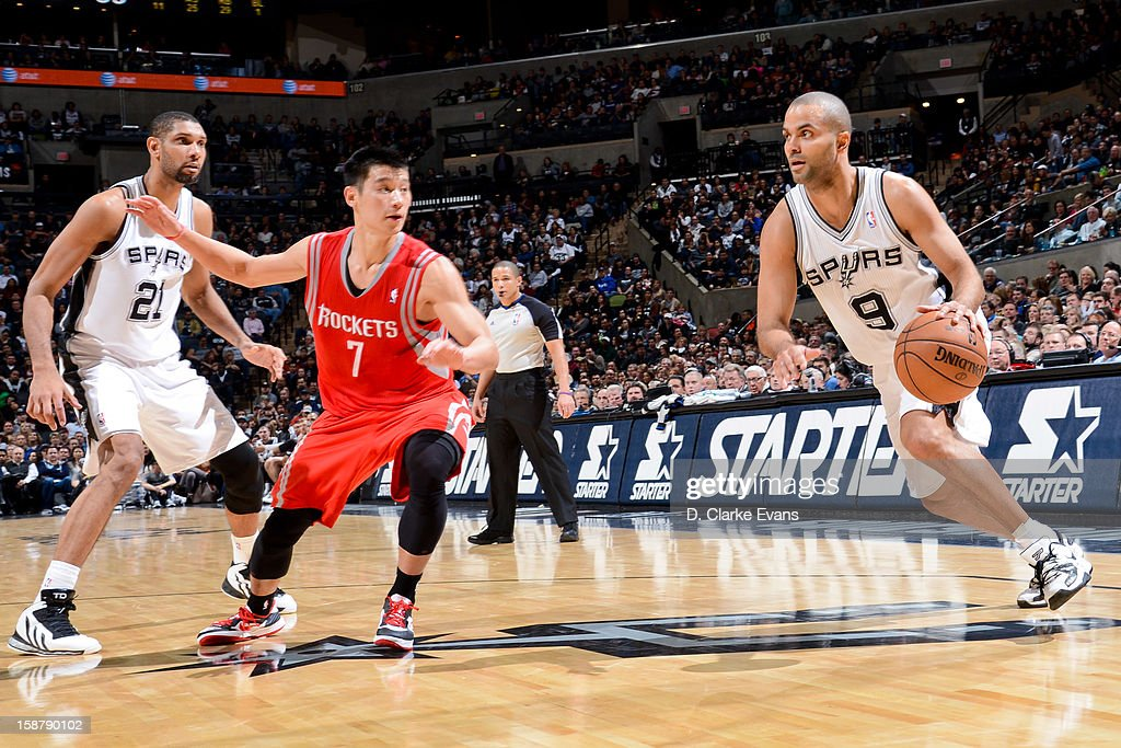 Tony Parker #9 of the San Antonio Spurs drives against Jeremy Lin #7 of the Houston Rockets on December 28, 2012 at the AT&T Center in San Antonio, Texas.