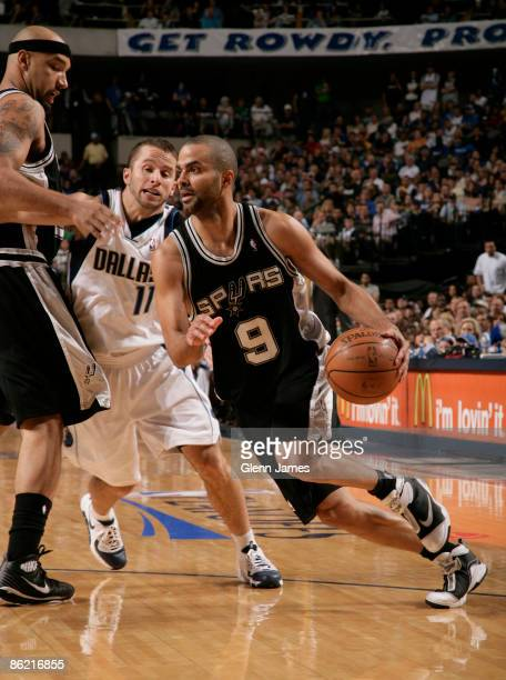 Tony Parker of the San Antonio Spurs drives against Jose Juan Barea of the Dallas Mavericks in Game Four of the Western Conference Quarterfinals...