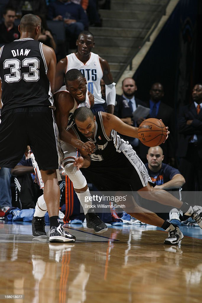 Tony Parker #9 of the San Antonio Spurs drives against Kemba Walker #15 of the Charlotte Bobcats at the Time Warner Cable Arena on December 8, 2012 in Charlotte, North Carolina.