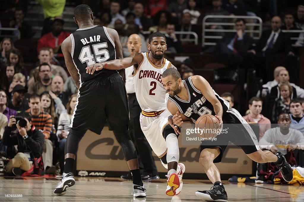 Tony Parker #9 of the San Antonio Spurs drives against <a gi-track='captionPersonalityLinkClicked' href=/galleries/search?phrase=Kyrie+Irving&family=editorial&specificpeople=6893971 ng-click='$event.stopPropagation()'>Kyrie Irving</a> #2 of the Cleveland Cavaliers at The Quicken Loans Arena on February 13, 2013 in Cleveland, Ohio.