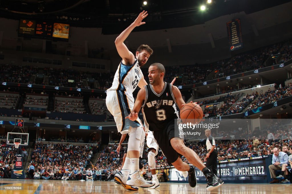 Tony Parker #9 of the San Antonio Spurs drives against Marc Gasol #33 of the Memphis Grizzlies on January 11, 2013 at FedExForum in Memphis, Tennessee.