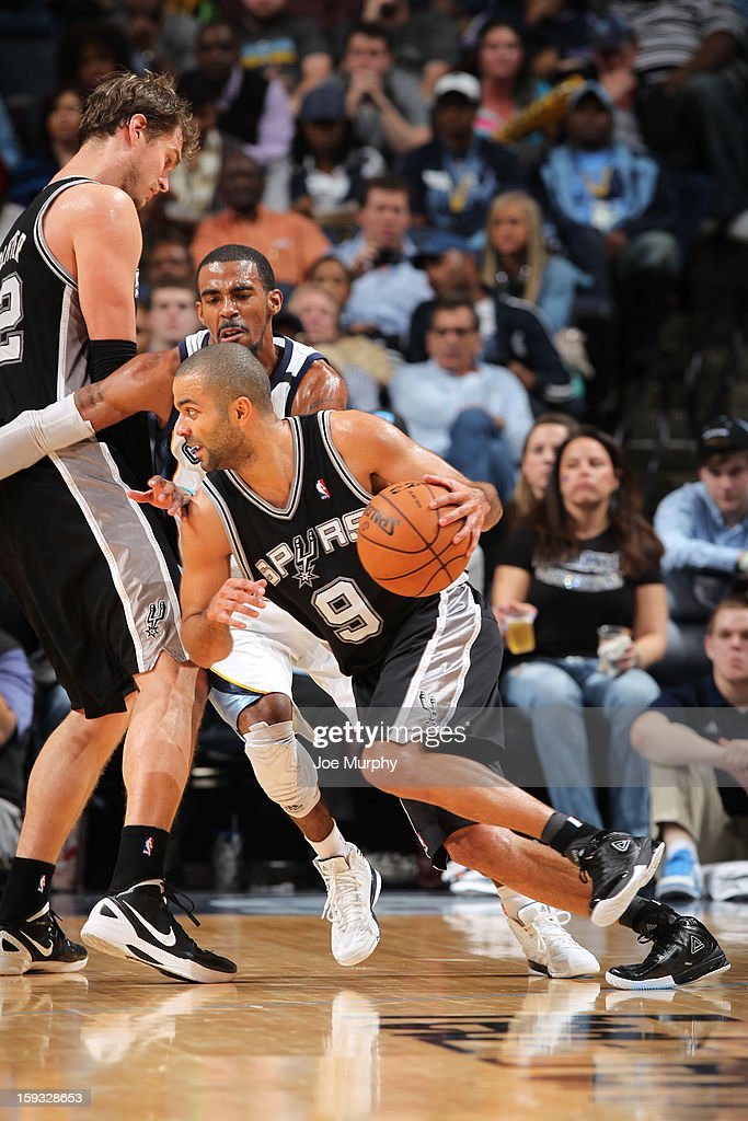 Tony Parker #9 of the San Antonio Spurs drives against Mike Conley #11of the Memphis Grizzlies on January 11, 2013 at FedExForum in Memphis, Tennessee.